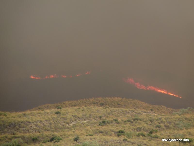 flames above Cabrera